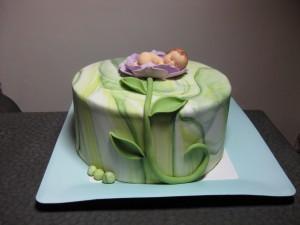 Grüne Tauftorte mit Baby
